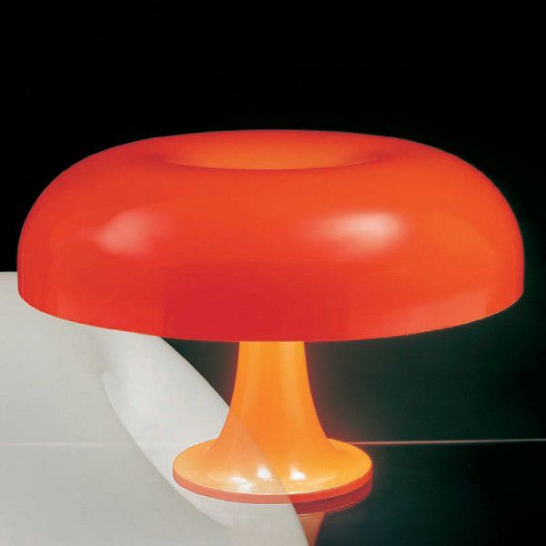 An orange Nesso table light