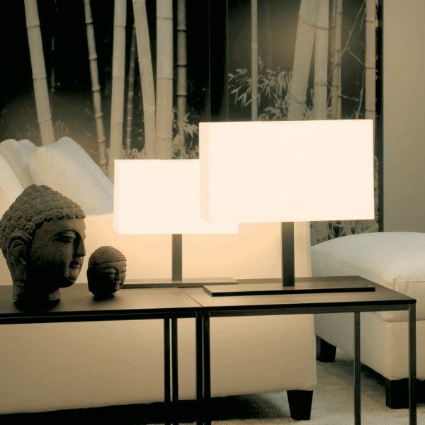 The Tosca table lights small and medium, made of white opal glass