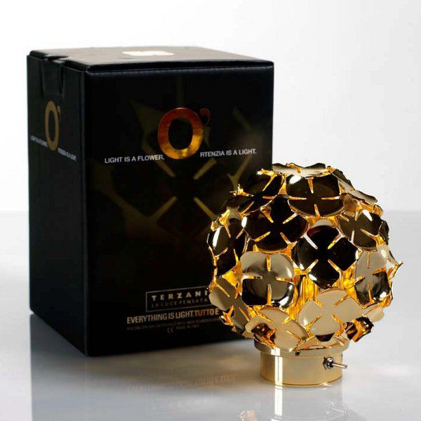 A gold-plated Orten`zia 11 table light with its gift box