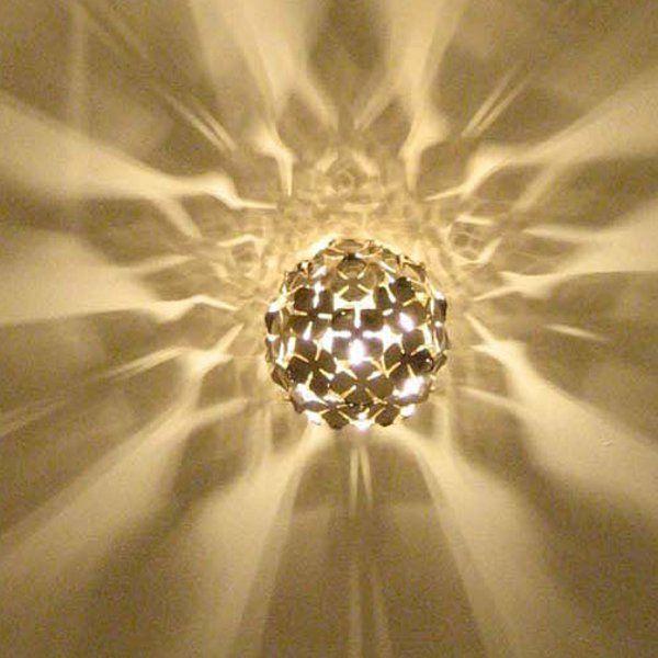 A golden Orten`zia 11 wall sconce/ceiling light